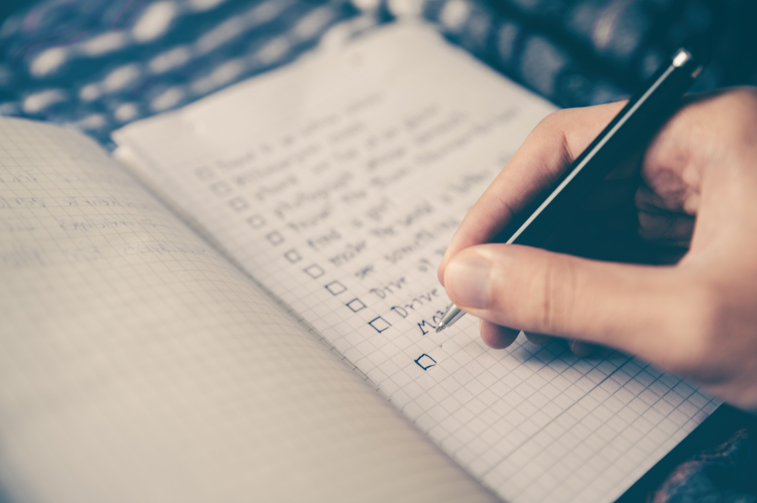 image of someone writing a list