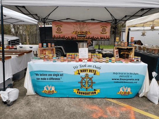 2 Navy Vets Foundation set up tent with their homemade seasoning