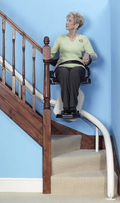 Image of a woman using a seated stairlift