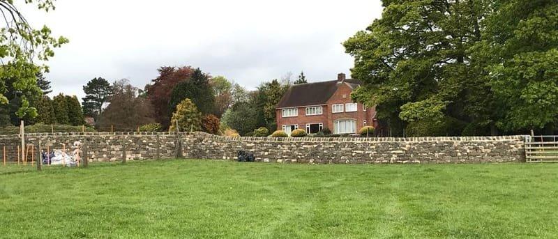 Large garden wall and ha ha.