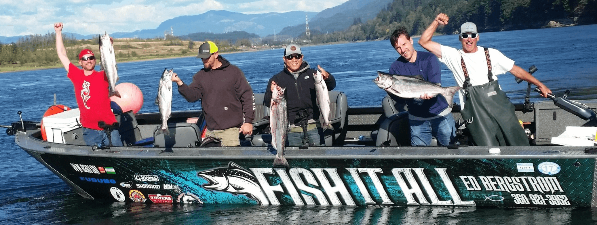 Five Men Standing In A Fishing Guide Boat Holding Up 5 Large Fish Caught In The Columbia River.