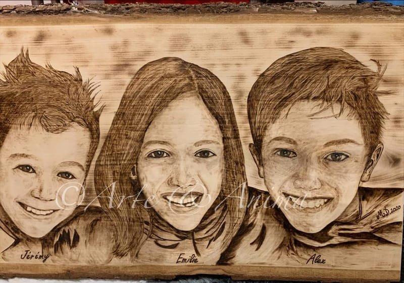 Ritratto con pirografo su legno grezzo 3 soggetti 65X35