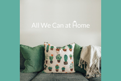 Cushions and blankets adorn a comfortable sofa. Words read 'All We Can at Home'