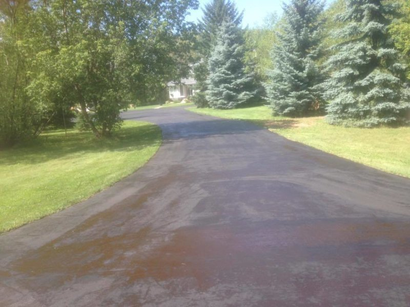 Acreage and driveway asphalt Paving & patching at its finest.!