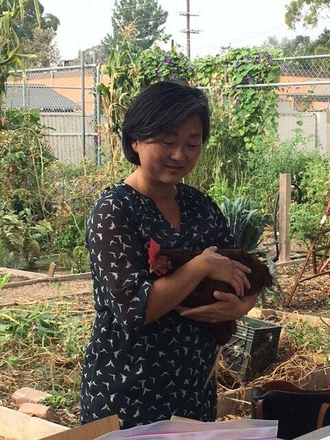 Roberta Kato and her chicken Peanut.