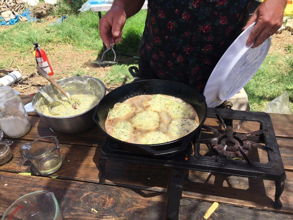 Cooking zucchini-feta pancakes