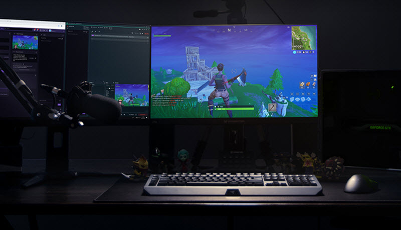 a dual-monitor setup is broadcasting Fortnite