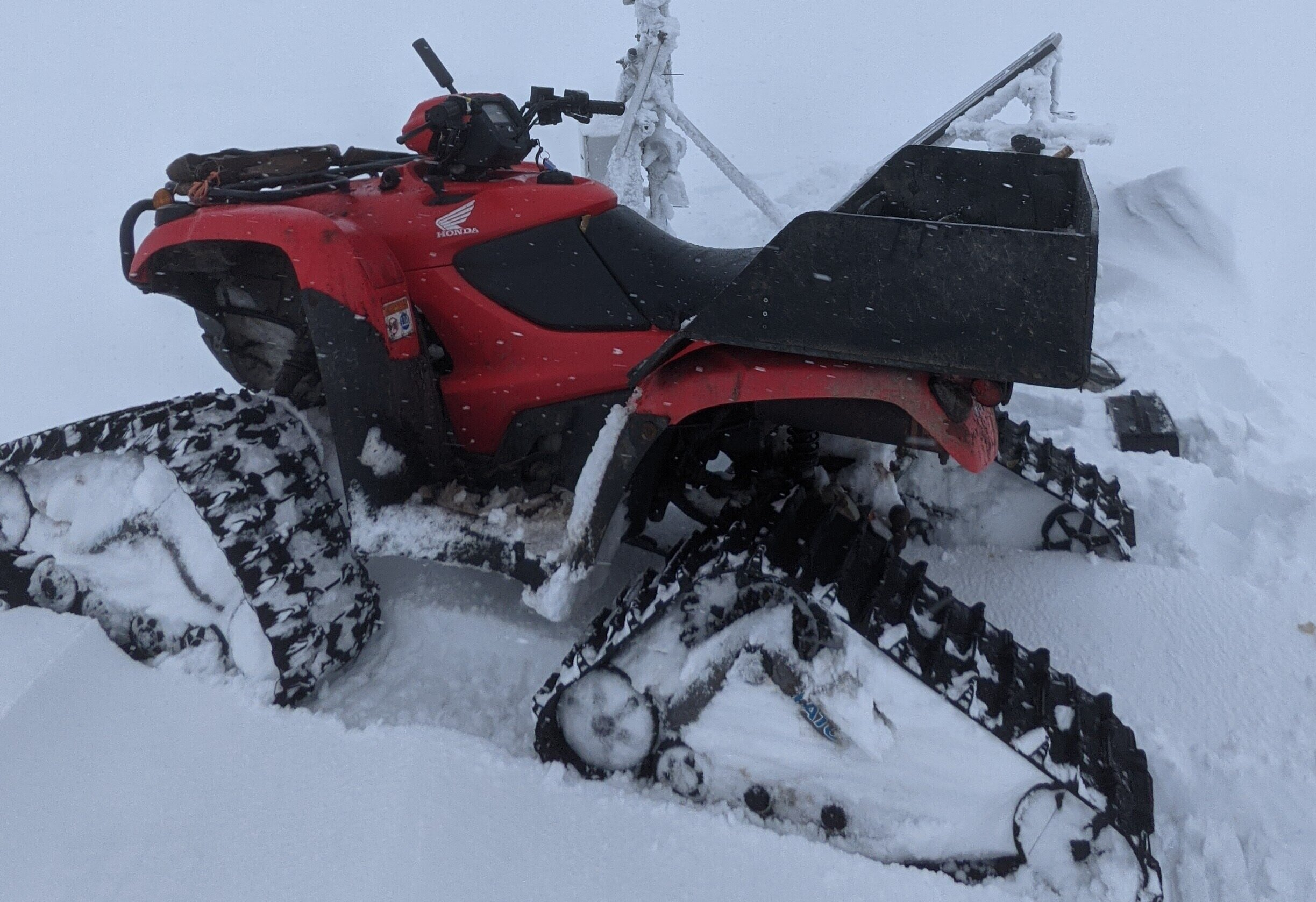 Tracked quad